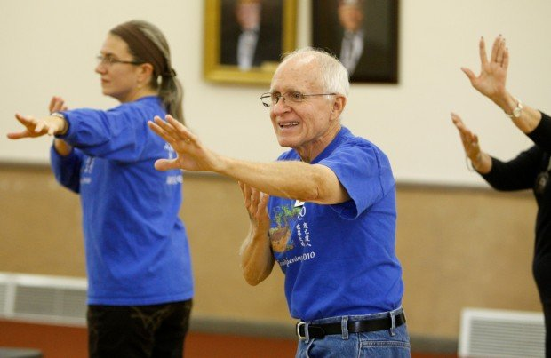 Joel Bowers participates in a Tai Chi demonstration