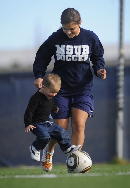 Sami Sandau plays with her 2-year-old son Koby