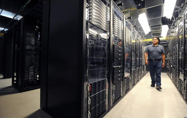 Andy York walks through a row of servers
