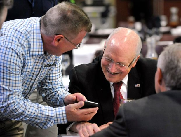 James Foster shows former Vice President Dick Cheney an old phot