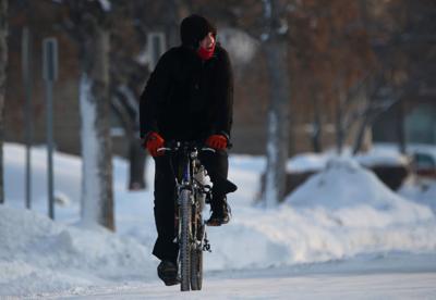 A man rides his bike