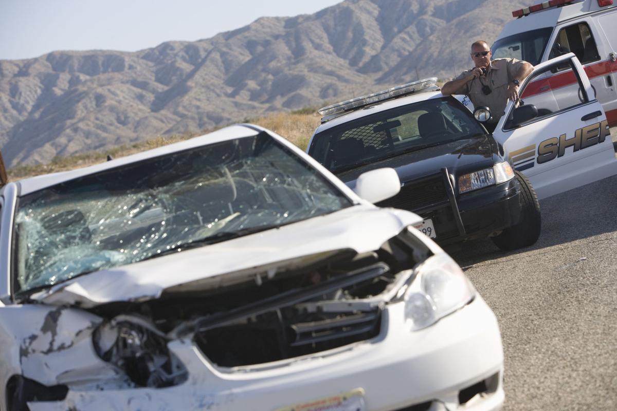 Sheriff reporting car crash stockimage