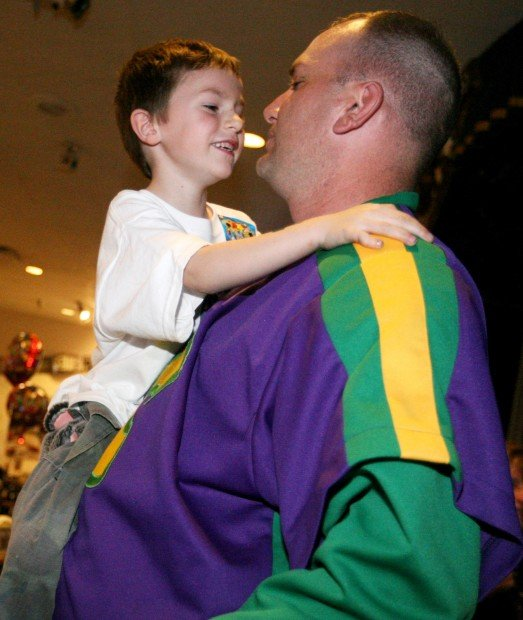 Christian Ankeny, 6, hangs on to his father