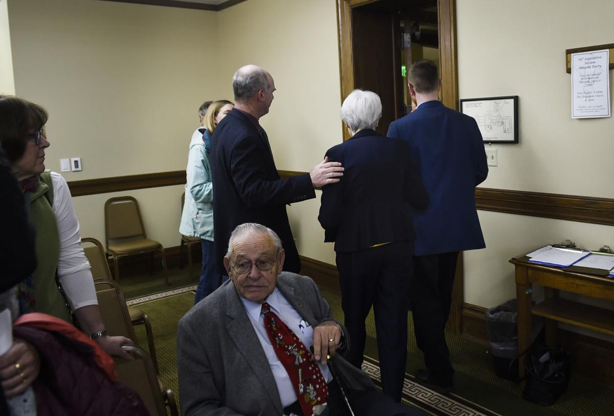 Carole Mackin of Helena, center, is escorted from the hearing