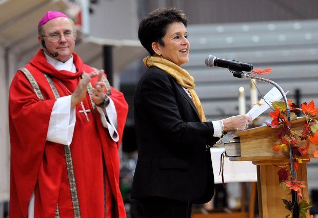 Rita Turley and Bishop Michael Warfel announce a new Catholic school