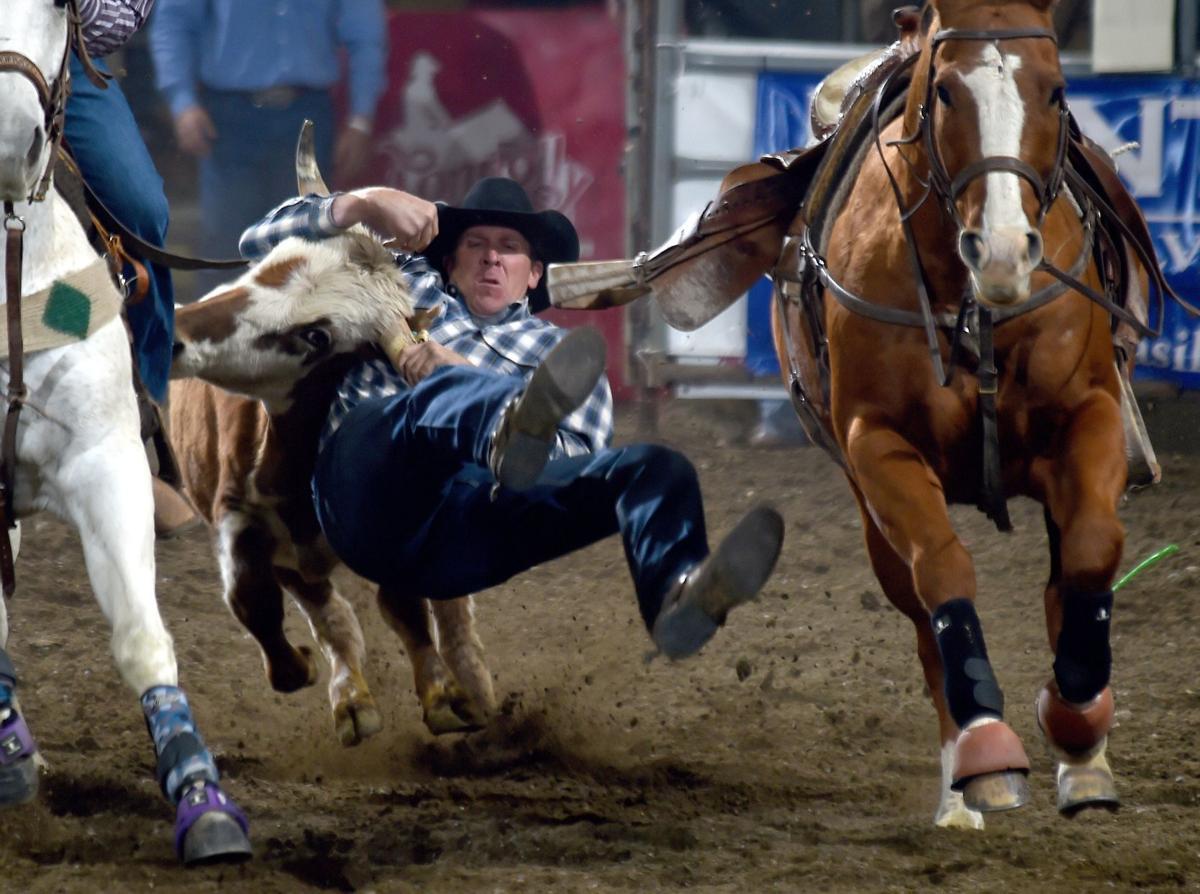 Hank Hollenbeck wrestles a steer