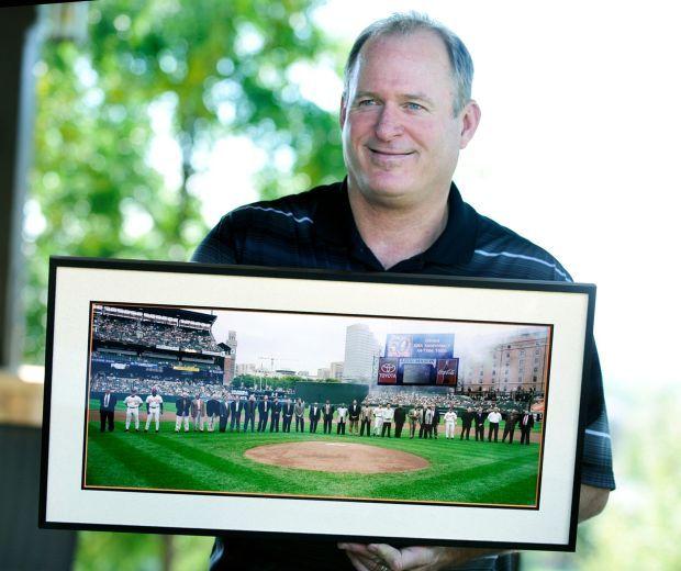 Jeff Ballard shows a photo.