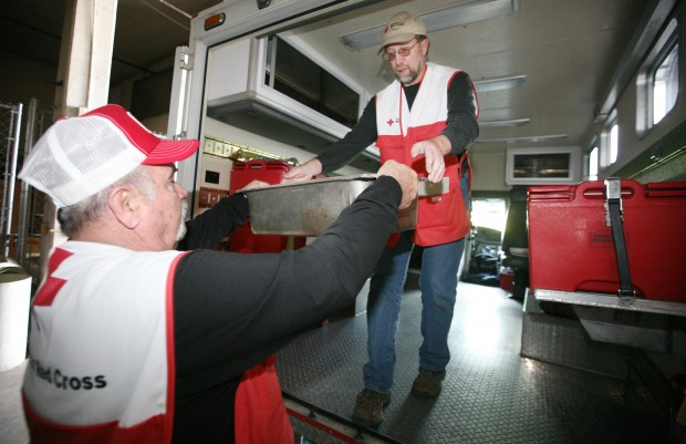 Red Cross workers load up the agency's emergency response vehicle