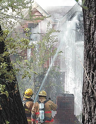 Grass fire damages buildings