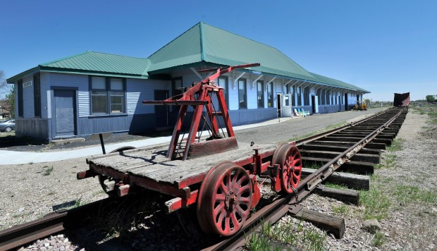 A hand cart sits on tracks at the Harlowton Milwaukee Depot.