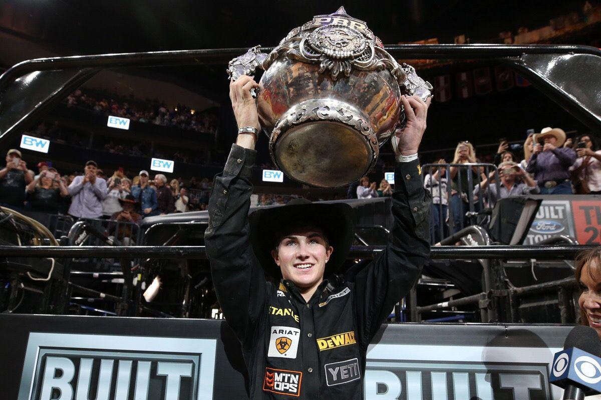 Jess Lockwood holds the championship trophy