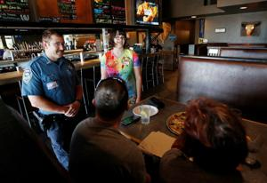 Tip-A-Cop event at Mackenzie River Pizza raises money for Special Olympics