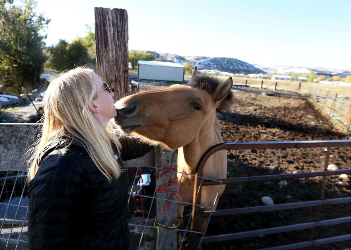 Alexis Bonogofsky greets her horse Sacha