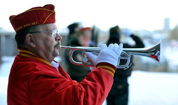Burt Gigoux from the Marine Corps League plays taps