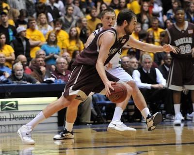 Montana's Derek Selvig drives past Montana State's Bobby Howard