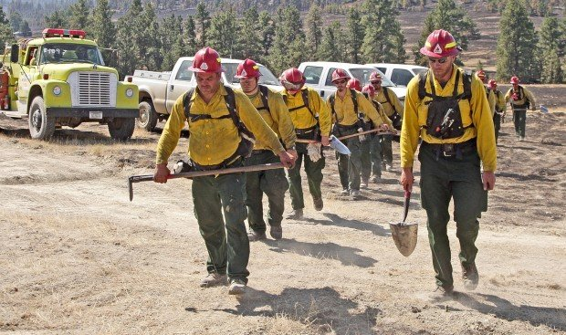 Firefighters head out to patrol a fire line