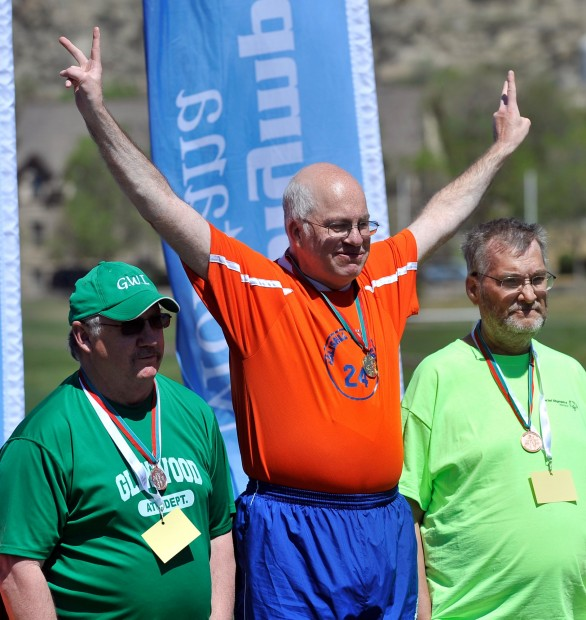 Scott Oliverson celebrates a gold medal in the shot put