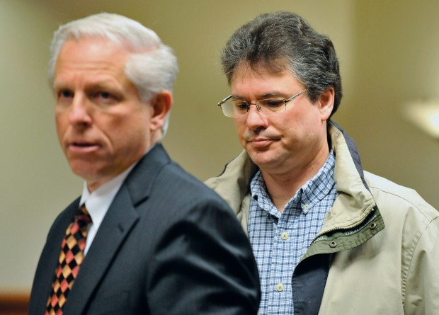 Stacey Rambold exits Judge Baugh's court room with his lawyer