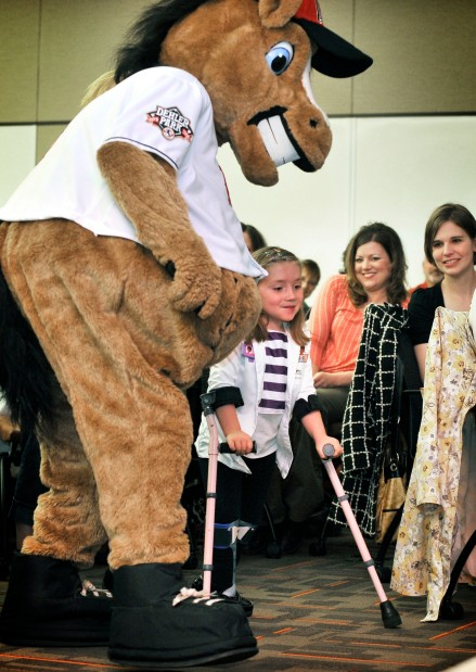 Six-year-old Alli Duncan walks to a podium escorted by Homer