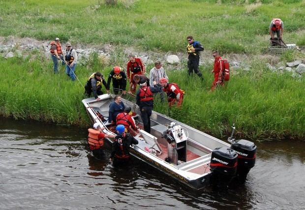 Rescuers tend to Kelly Keller of Whitehall