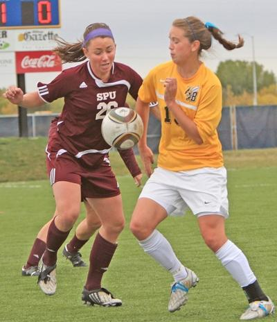 Jaucelyn Richter of MSUB battles with Seattle Pacific's Janie Wurth
