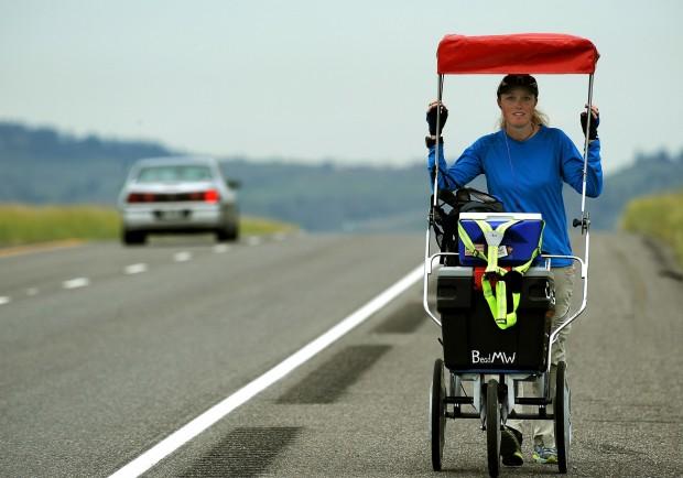 Stacie Eichinger walks down Interstate 90