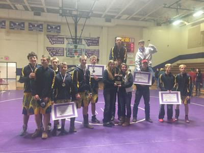 Miles City wrestlers pose for a picture after winning the Forsyth tournament