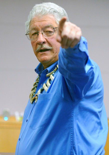 Jim Leachman points to a law officer