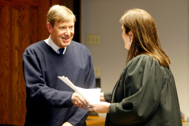Brent Cromley is congratulated by judge Sheila Kolar