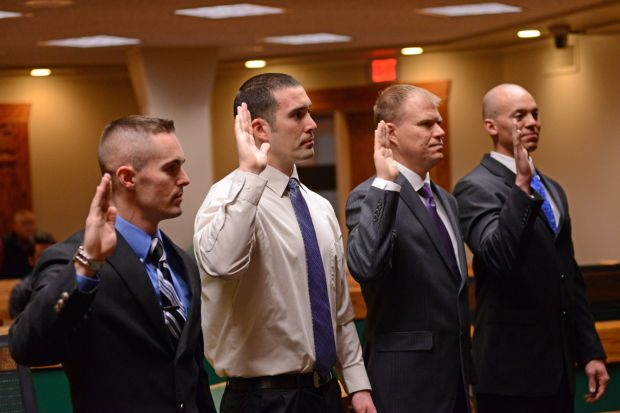 Four new police officers are sworn in