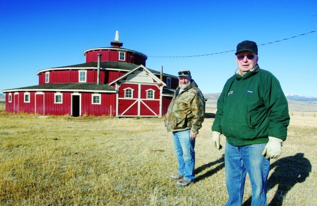 Tom Hyndman, left, and Byron Bayers toured the round barn