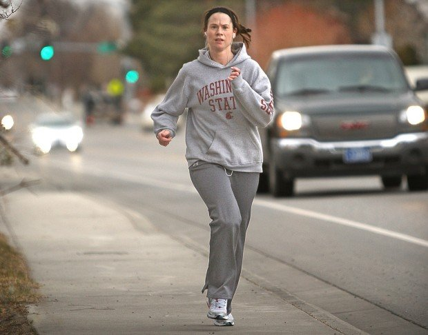A runner makes her way down Rimrock Road