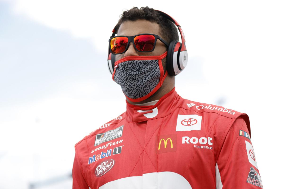 Bubba Wallace, the driver of the DoorDash Toyota, waits on the grid prior to the NASCAR Cup Series 63rd Annual Daytona 500 at Daytona International Speedway on February 14, 2021, in Daytona Beach, Florida.
