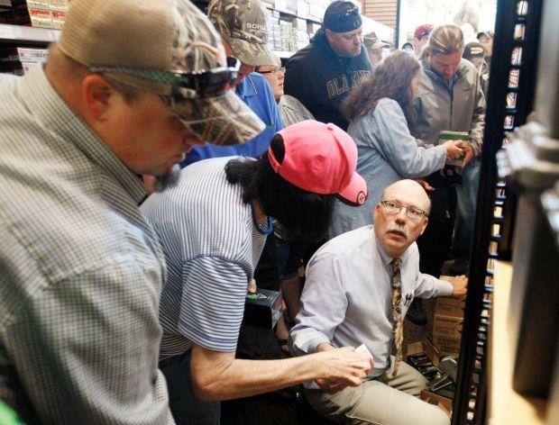 A Scheels employee helps customers
