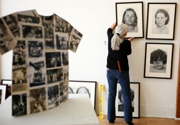 Jane Waggoner Deschner hangs her work