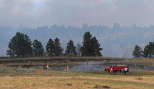 Grass fire ignites west of Pompeys Pillar