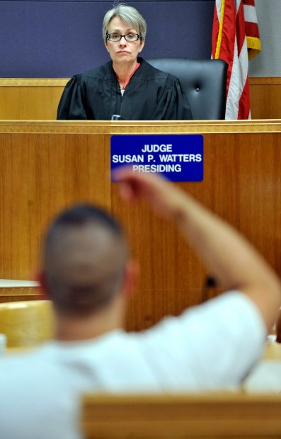 Judge Susan Watters interviews a man in drug court