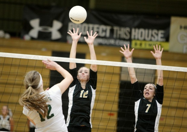KC Christensen (12) and Katie Zink of West rise for a block