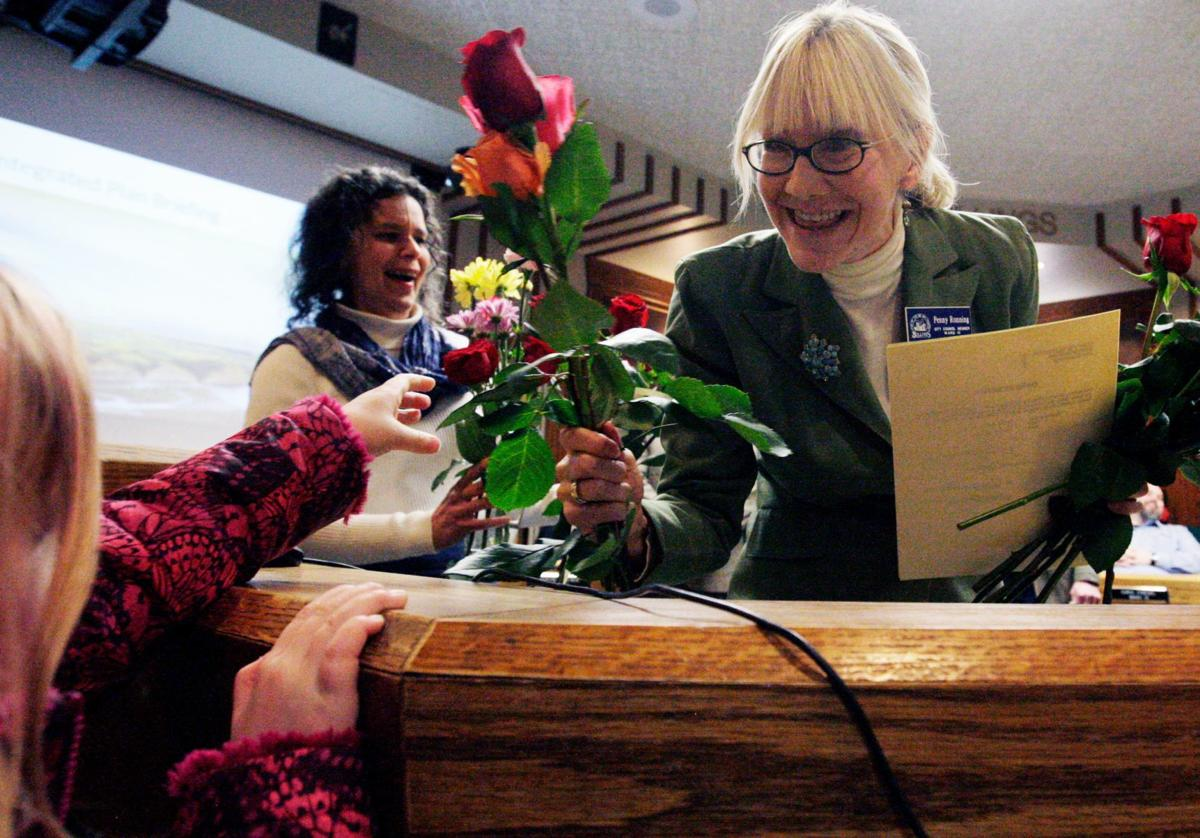 Tillie Lammers, 5, hands new city council member Penny Ronning flowers