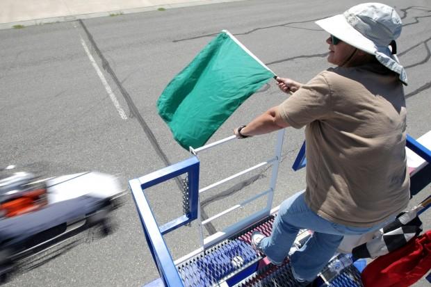 Jacki Miner of Cody, Wyo. holds a green flag