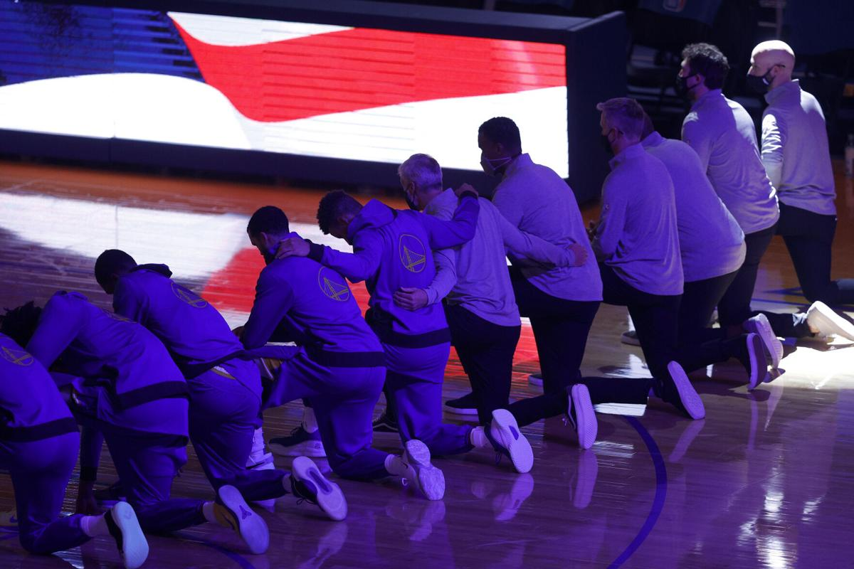 The Golden State Warriors kneel for the national anthem before a game against the Los Angeles Clippers at Chase Center in San Francisco on January 6, 2021.