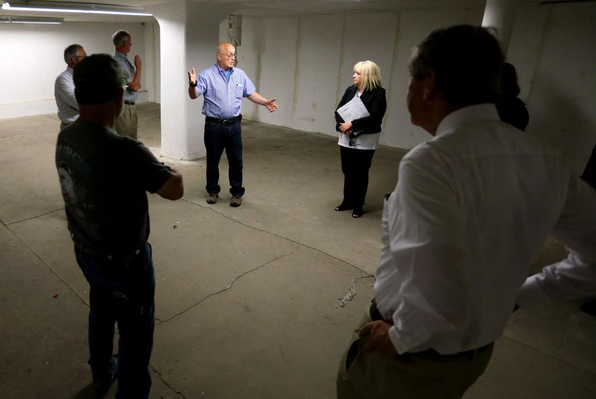 Marty Connell leads a tour of the Kairos Center