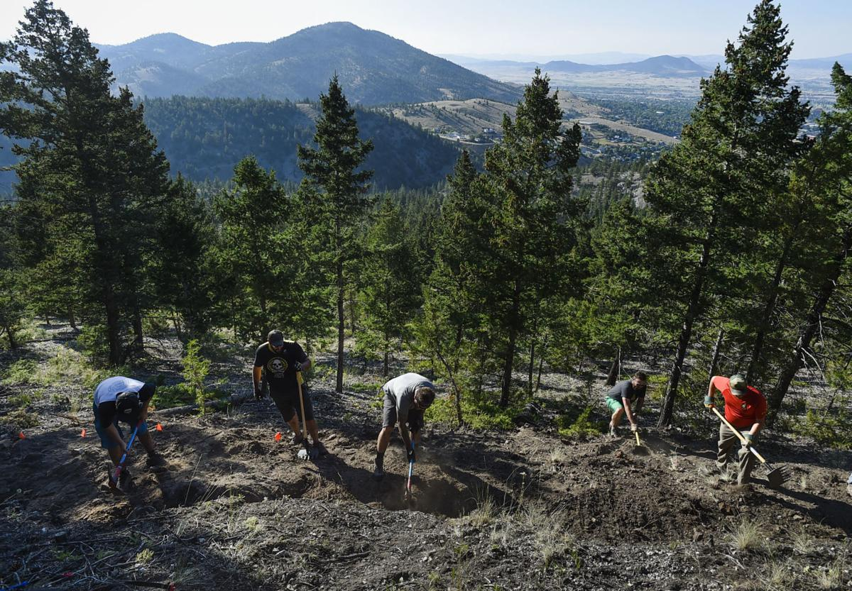 Volunteers help build a trail on Mount Ascension