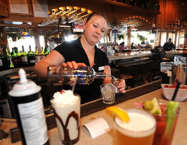 Bartender Jenna Brouillard serves up a variety of drinks at Applebee's