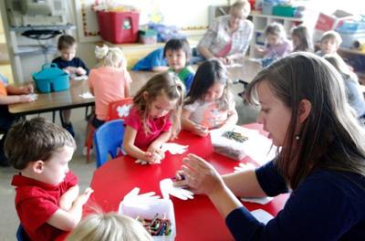 Teacher Amy Whittle works with students