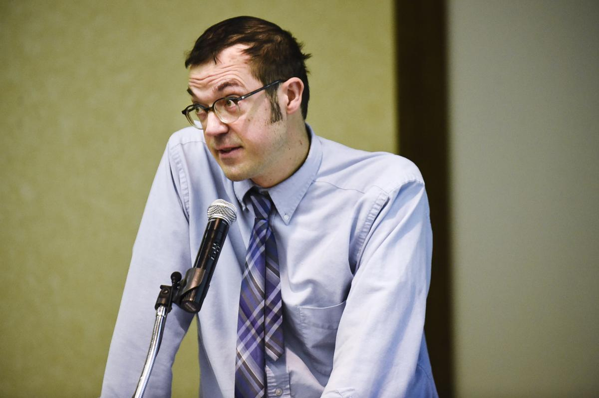 Tom Bourguignon, a foster parent, speaks in opposition Thursday during a hearing on the administrative rules to change Medicaid reimbursements and service eliminations at the Department of Health and Human Service.