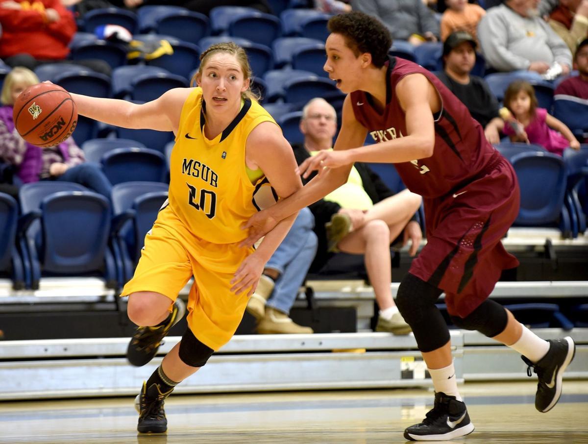 Alisha Breen drives for the basket