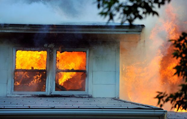 Flames engulf an upstairs room