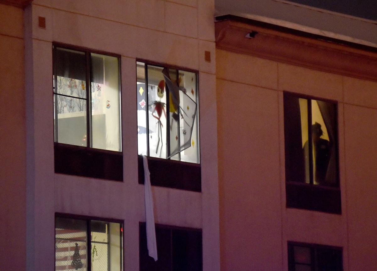 Person falls from Passages 3rd story window