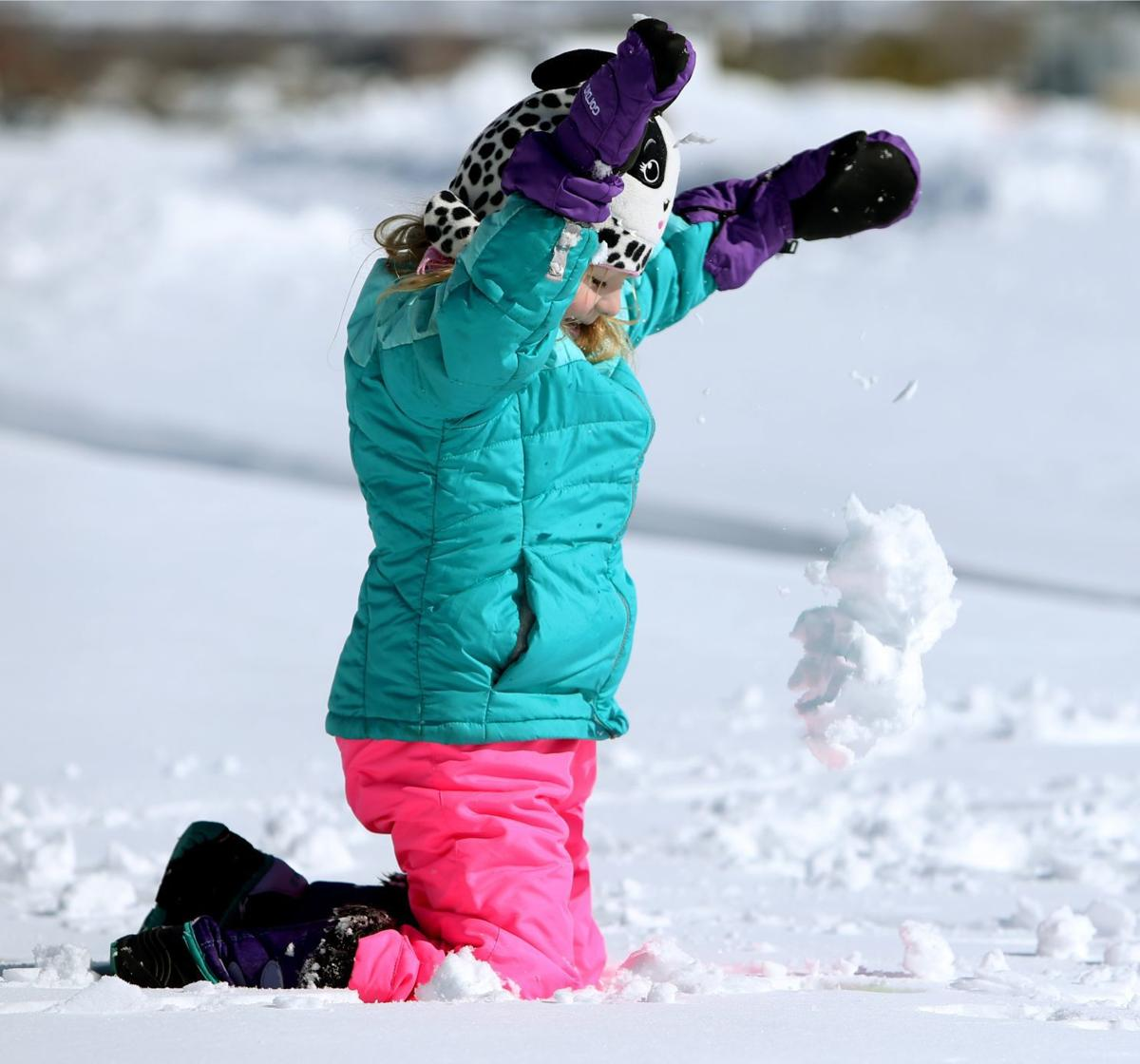 Madelyln Thomassen plays in the snow